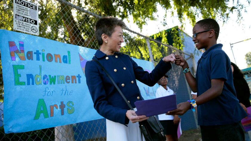 Jane Chu, chairperson of the National Endowment for the Arts, greets 4th-grader Jamiah Walker, 10, at Martin Luther King Jr. Elementary School in Los Angeles in 2015.