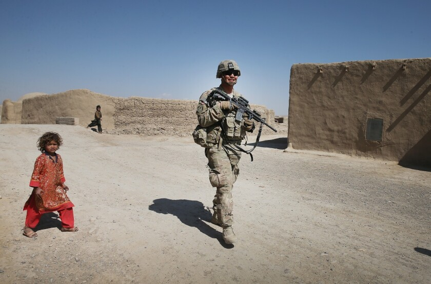 An American soldier on patrol near Kandahar, Afghanistan. When the U.S. leaves Afghanistan our position will be: We're outta here; you guys sort this out.