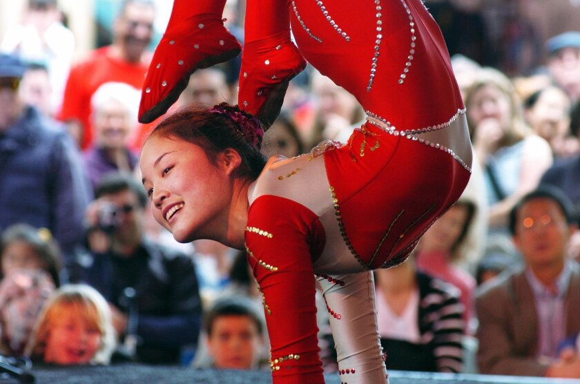 Contortionist Kong Chunmei, with, China Star Acrobatics, performs during a past Chinese New Year festival in Downtown San Diego. CREDIT: Sandy Huffaker