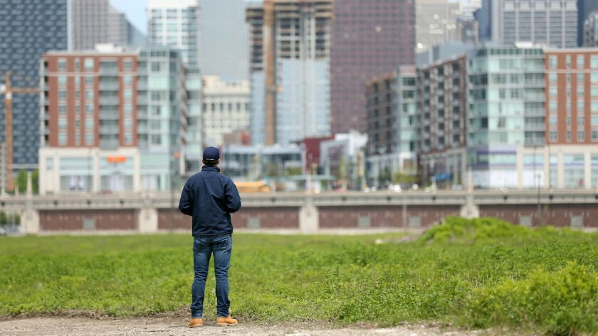 Curt Bailey, president of Related Midwest, pauses during a May 2017 tour of a 62-acre parcel of land Related Midwest wants to develop south of Roosevelt Road. Members of Amazon's HQ2 site selection team visited the parcel last month, according to sources.
