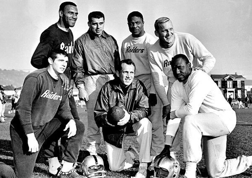 Oakland coach and general manager Al Davis, holding football, joins Raiders players named to the Associated Press 1963 American Football League All-Star team. From left are defensive halfbacks Tommy Morrow and Fred Williamson, linebacker Archie Matsos, halfback Clem Daniels, center Jim Otto and end Art Powell.