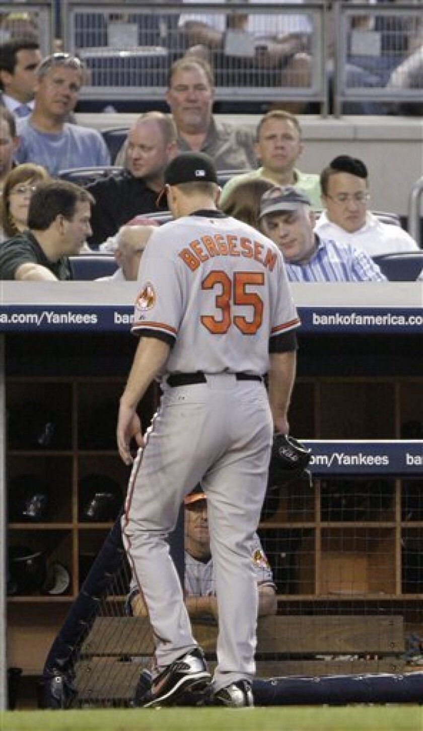 Baltimore Orioles starting pitcher Brad Bergesen leaves the game after hitting New York Yankees' Francisco Cervelli with a pitch to walk in a run during the third inning of a baseball game Wednesday, June 2, 2010, in New York. (AP Photo/Frank Franklin II)