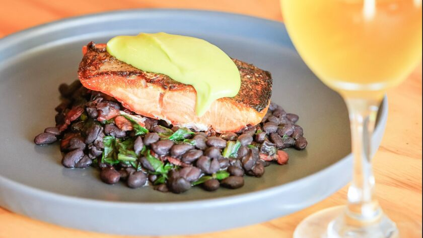 SAN DIEGO, CA January 11th, 2018 | Seared Salmon with pesto aioli and black beans by Chef William Ei