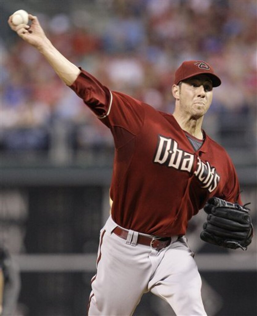 FILE - In this Aug. 18, 2009 file photo, Arizona Diamondbacks' Jon Garland pitches in the second inning of a baseball game against the Philadelphia Phillies in Philadelphia. The Los Angeles Dodgers acquired Garland from the Arizona Diamondbacks on Monday night, Aug. 31, 2009. Also joining the Dodge
