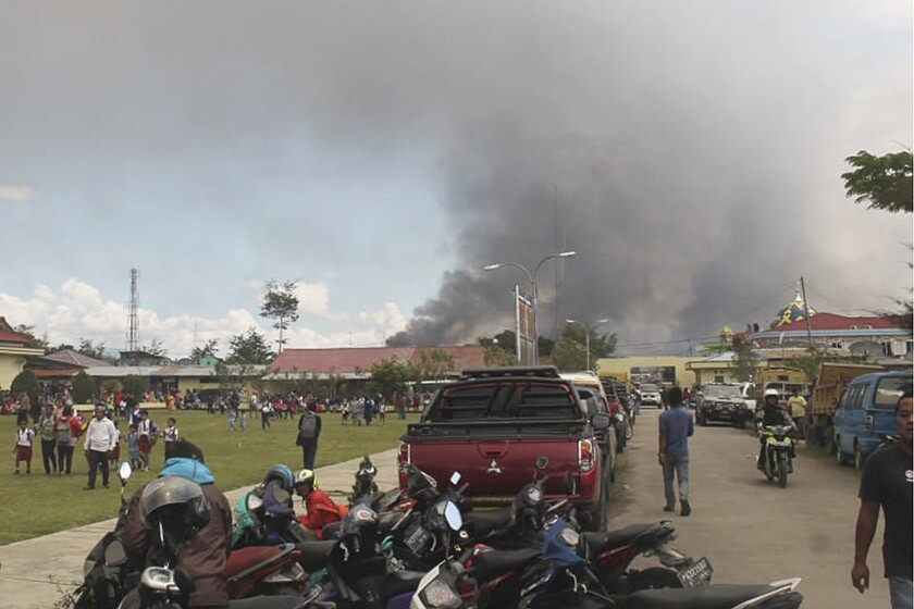 Smoke billows from a burning building during protests Sept. 23 in Wamena, Papua province, Indonesia.