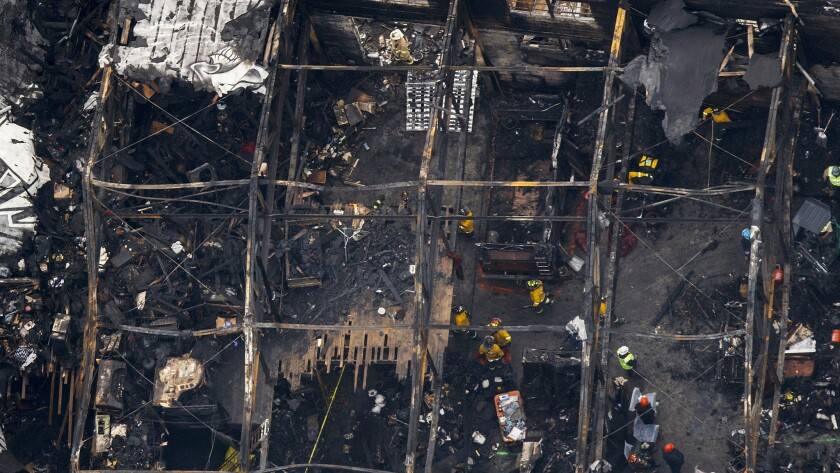 """OAKLAND,CA --MONDAY, DECEMBER 05, 2016--An aerial view of the """"Ghostship"""" warehouse that burned and"""