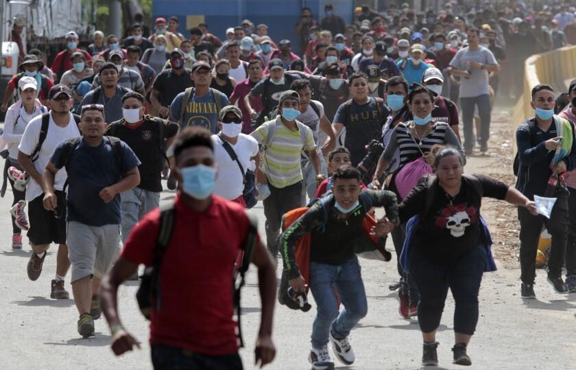 Migrants attempt to cross en masse into Guatemala at Corinto, Honduras, on Oct. 1, 2020.