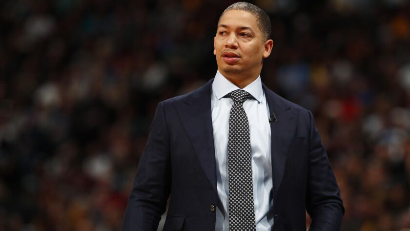 Tyronn Lue looks on during a game between the Cleveland Cavaliers and Denver Nuggets in March 2018.