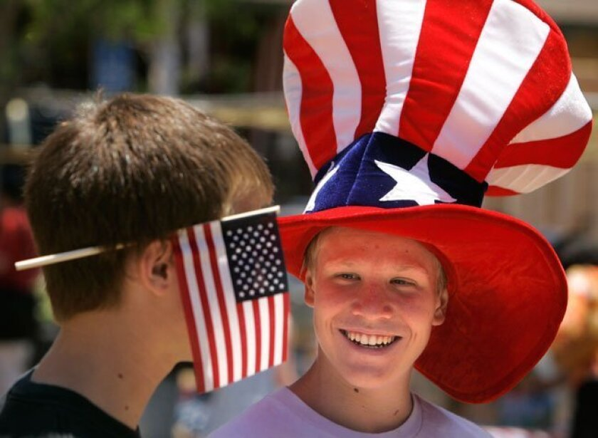 """Brothers Tanner Orr, 17 (left), and Spencer, 14, show their patriotism during Independence Day festivities at Old Poway Park, dubbed """"An Old-Fashioned Fourth of July."""""""