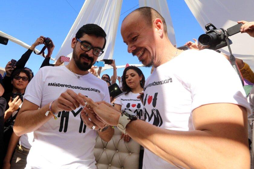 Victor Fernando Urias Amparo and Victor Manuel Aguirre Espinoza exchange rings Saturday in Baja California's first same-sex wedding in Mexicali.