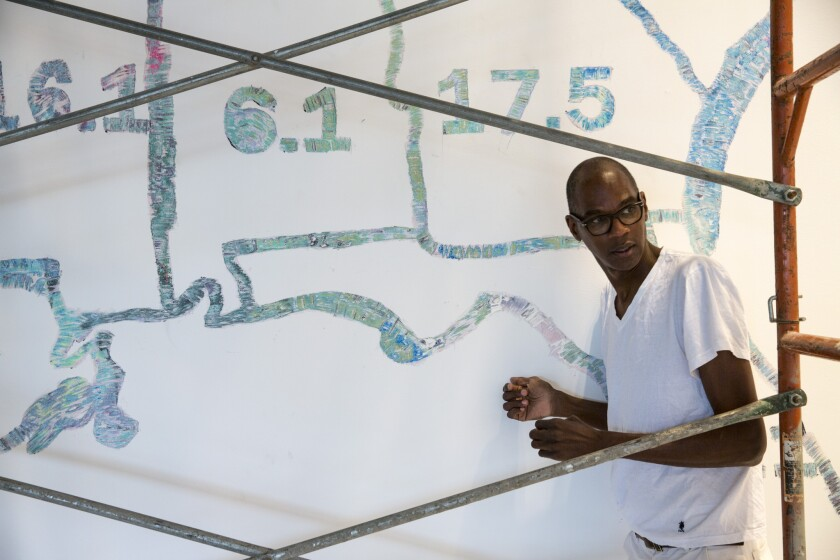 """Los Angeles-born artist Mark Bradford, in front of his """"Finding Barry, 2015,"""" at the Hammer Museum in Westwood."""