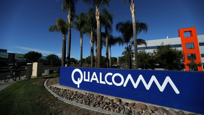 FILE PHOTO: A sign on the Qualcomm campus is seen in San Diego, California, U.S. November 6, 2017.