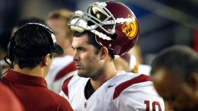 USC quarterback John David Booty is consoled after throwing an interception against UCLA late in the fourth quarter at the Rose Bowl on Dec. 2, 2006.