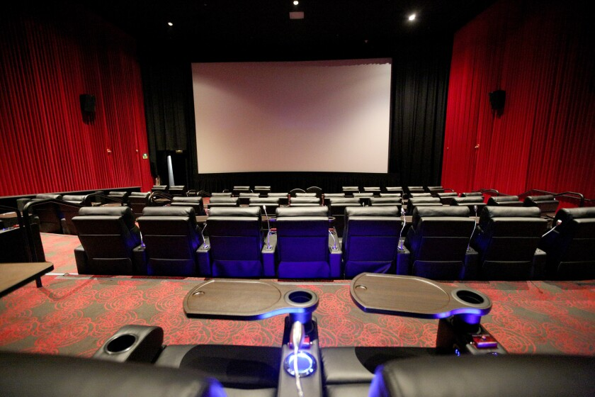 Studio Movie Grill opened the doors of its Glendale location on Oct. 17. Patrons of the national theater chain can order food and drinks to their seat at the touch of a button.