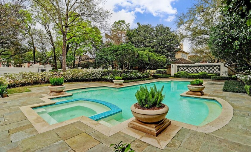 The quarter-acre property is tucked behind a French manor-style home that he sold last year.