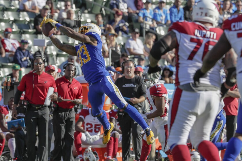Chargers safety Derwin James intercepts a pass against the Cardinals last season.