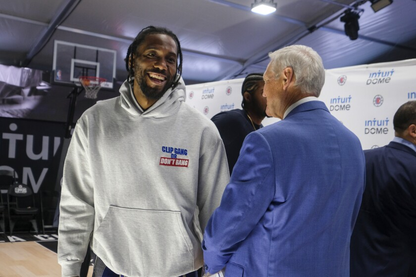 Clippers star Kawhi Leonard chats with NBA legend Jerry West.