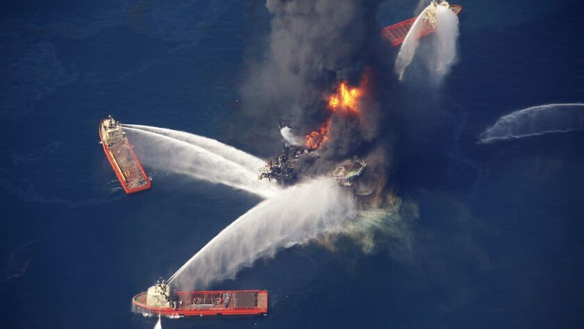 FILE - In this April 21, 2010, file photo, the Deepwater Horizon oil rig burns in the Gulf of Mexico