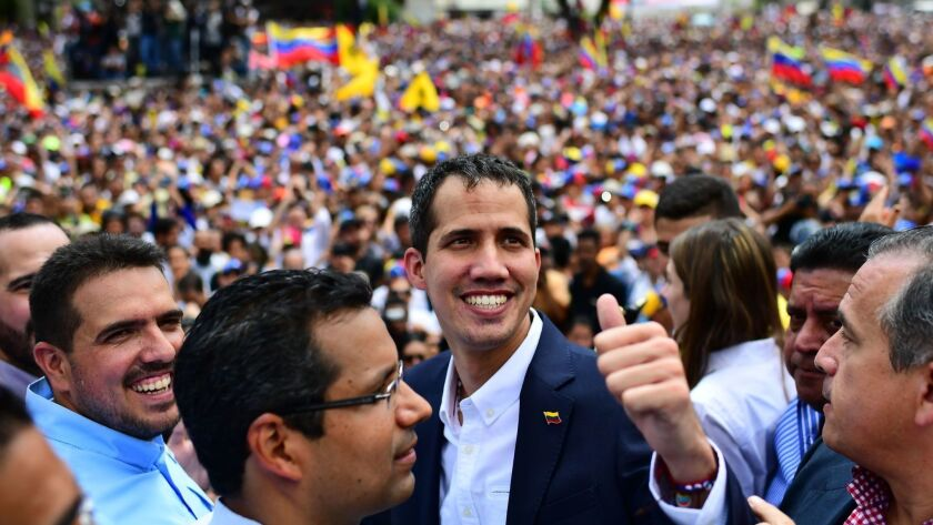 Venezuelan opposition leader and self-proclaimed acting president Juan Guaido gives the thumbs up signal during a rally Monday after his return to Caracas.