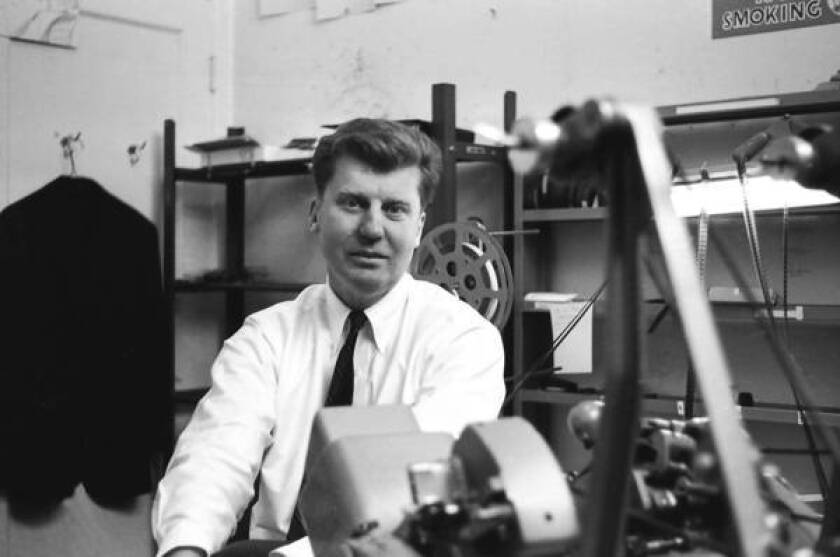"""William Cartwright is shown in his editing room in 1963. He said: """"We knew we had to do something that we believed should have been done before us: preserving something that needed it and not abandoning it."""""""