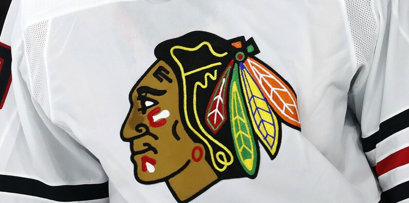 FILE - In this May 3, 2021, file photo, the Chicago Blackhawks logo is displayed on a jersey in Raleigh, N.C. An attorney who represents a former Blackhawks player who alleges he was sexually assaulted by a then-assistant coach in 2010 says her client has been interviewed as part of the team's review of the accusations. (AP Photo/Karl B DeBlaker, File)
