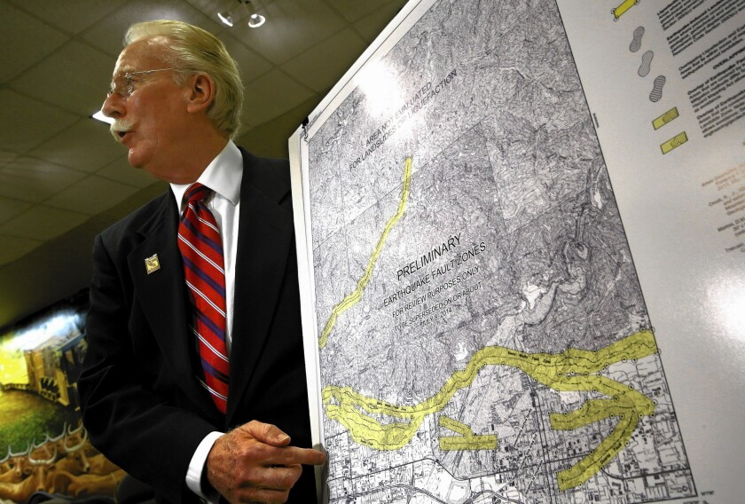 State geologist John Parrish presents a new map of the Sierra Madre fault in the foothill cities of eastern Los Angeles County during a news conference at which the Hollywood fault was also discussed.
