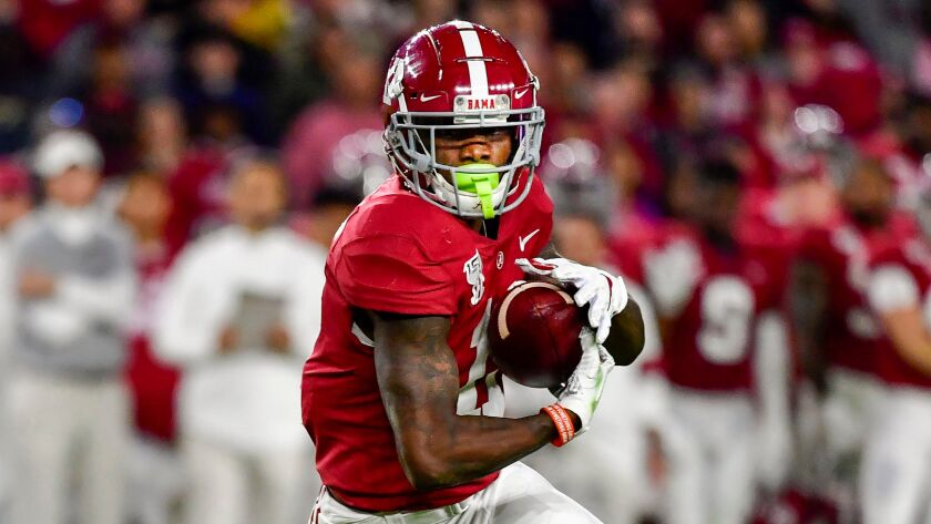 Alabama receiver Henry Ruggs III runs after a catch.