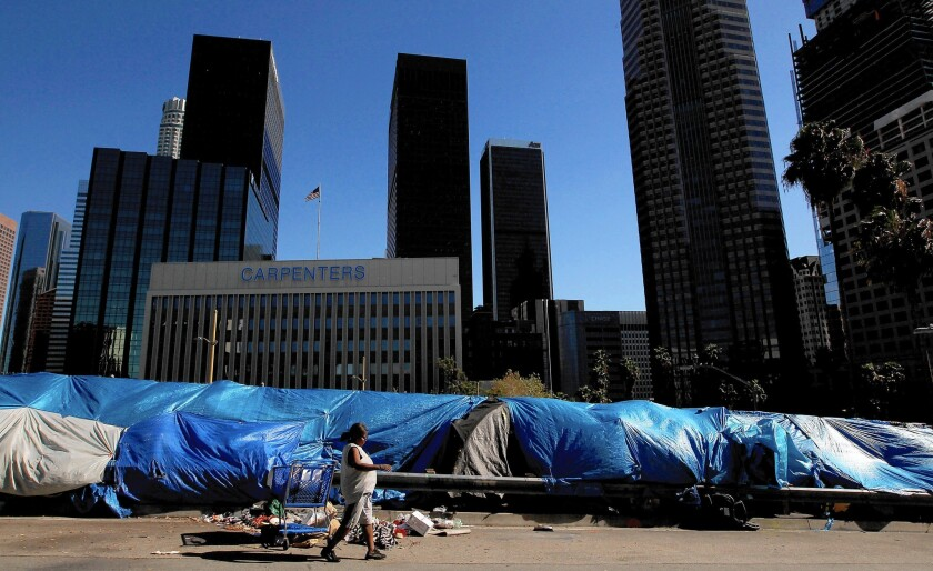 Shown is a homeless encampment in downtown L.A. at Beaudry Avenue and 6th Street. Los Angeles County supervisors voted Tuesday to put up to $100 million a year into a fund for affordable housing.