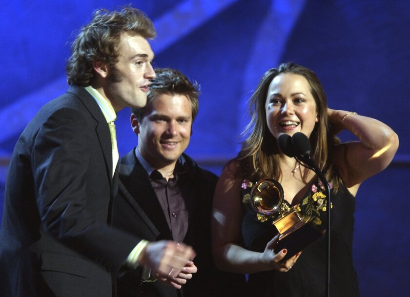 Nickel Creek members from left, Chris Thile, Sean Watkins, and Sara Watkins, accept the award for best contemporary folk album during the pre-telecast of the 45th Annual Grammy Awards in New York, Sunday, Feb. 23, 2003. (AP Photo/Mark Lennihan)