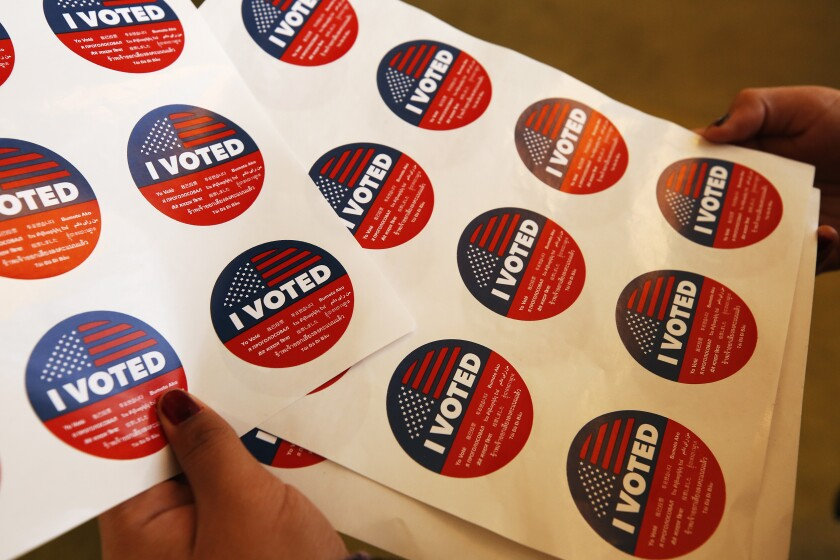 """A close-up of """"I voted"""" stickers"""