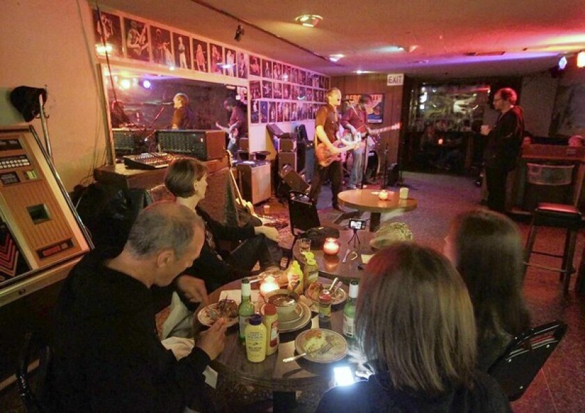 Diners watching the band Verily in Canter's Kibitz Room.