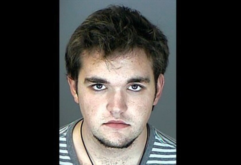FILE - This undated booking photo released by the Westminster, Colo., Police Department shows Austin Reed Sigg, 18, who is charged with murder and other crimes in the abduction and slaying of 10-year-old Jessica Ridgeway. Sigg, is to enter a plea in the Oct. 5 disappearance and slaying of Jessica R