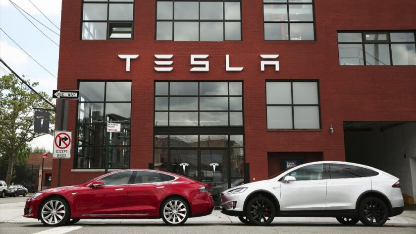 Tesla Motors vehicles sit parked outside a new Tesla showroom and service center in Brooklyn, N.Y.'s Red Hook neighborhood July 5.