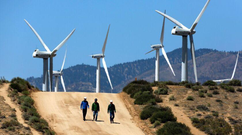 TEHACHAPI, CA - MAY 23, 2013: Gregory Wetstone, left, Randy Hoyle and Kevin Martin of Terra-Gen Powe