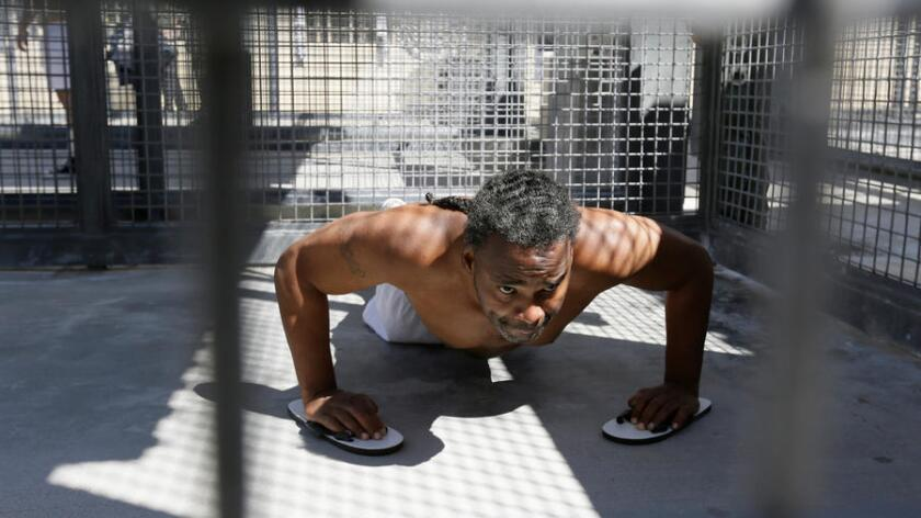 Condemned inmate Donald DeBose does pushups in a caged recreation yard space on death row at San Quentin State Prison on Aug. 16.