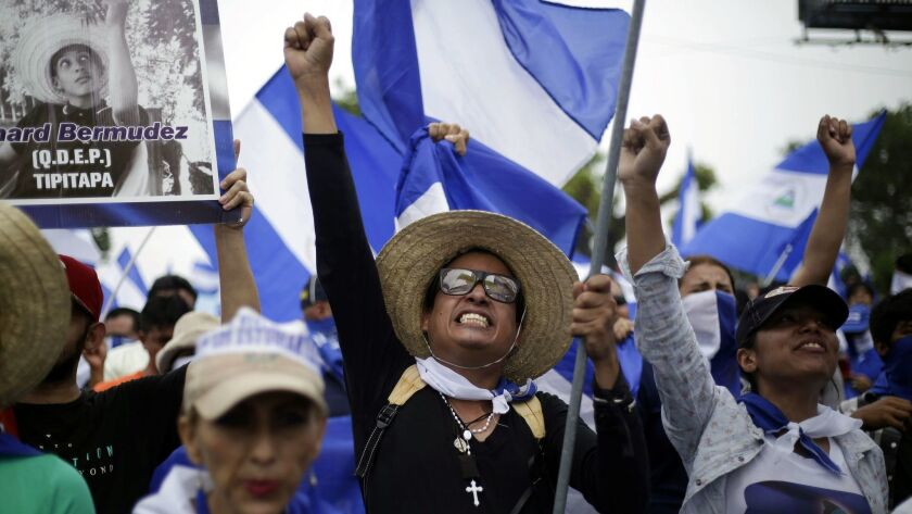 People participate in a march calling for President Daniel Ortega to be ousted in Managua, Nicaragua, on July 23, 2018.
