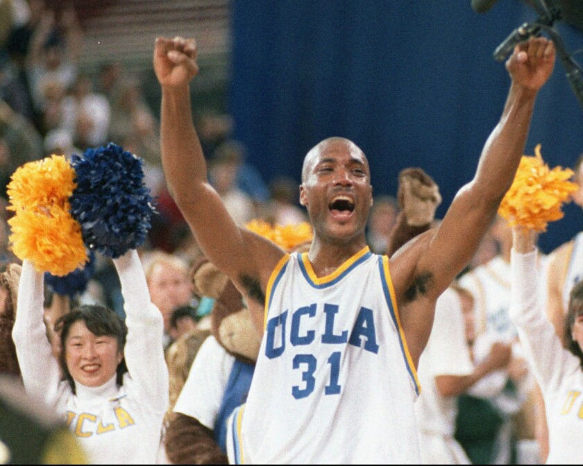 A lawsuit brought by former UCLA basketball player Ed O'Bannon, seen above in 1995, challenged the NCAA rule requiring student athletes to give up any claim to the revenue from television broadcasts, replays, highlight reels, videogames and any other use of their names, images or likenesses. A federal judge has ruled that the NCAA can't stop college football and basketball players from selling the rights to their names and likenesses, opening the way to athletes getting payouts once their college careers are over.