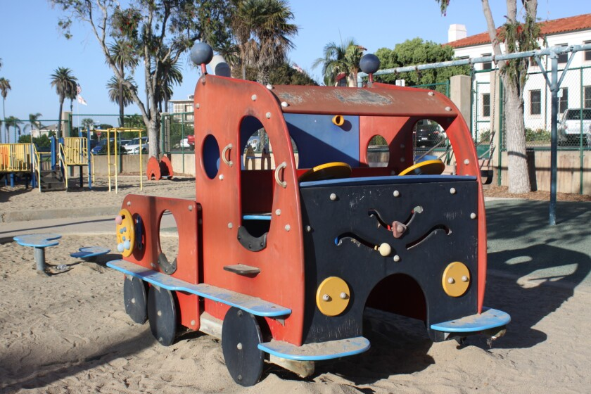 The play structure known as The Firetruck has scuffs and scrapes from regular use.