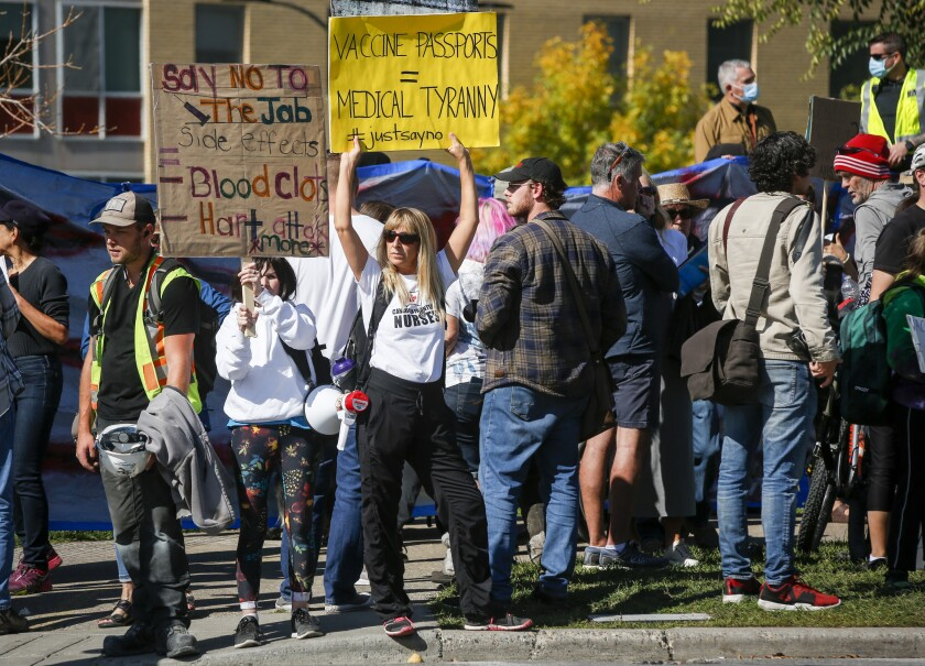 Protesters gather at the Foothills Hospital to oppose COVID-19 related public health measures in Calgary, Alberta, Canada, on Monday, Sept. 13, 2021. (Jeff McIntosh/The Canadian Press via AP)