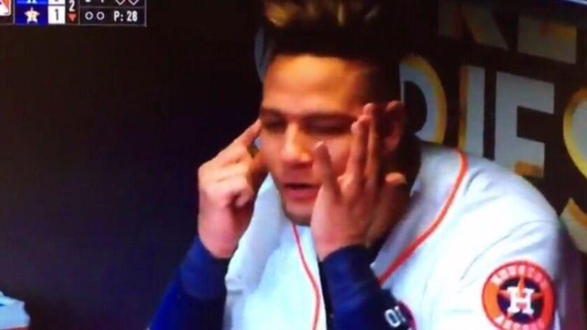 Astros first baseman Yuli Gurriel makes a gesture referencing Dodgers Japanese-Iranian pitcher Yu Da