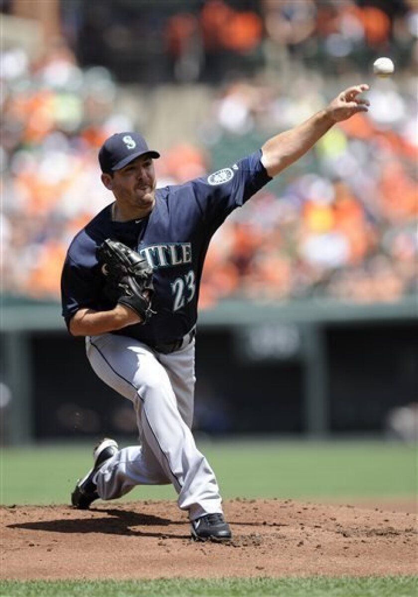 Seattle Mariners starting pitcher Joe Saunders delivers a pitch against the Baltimore Orioles during the first inning of an MLB American league baseball game, Sunday, Aug. 4, 2013, in Baltimore. (AP Photo/Nick Wass)