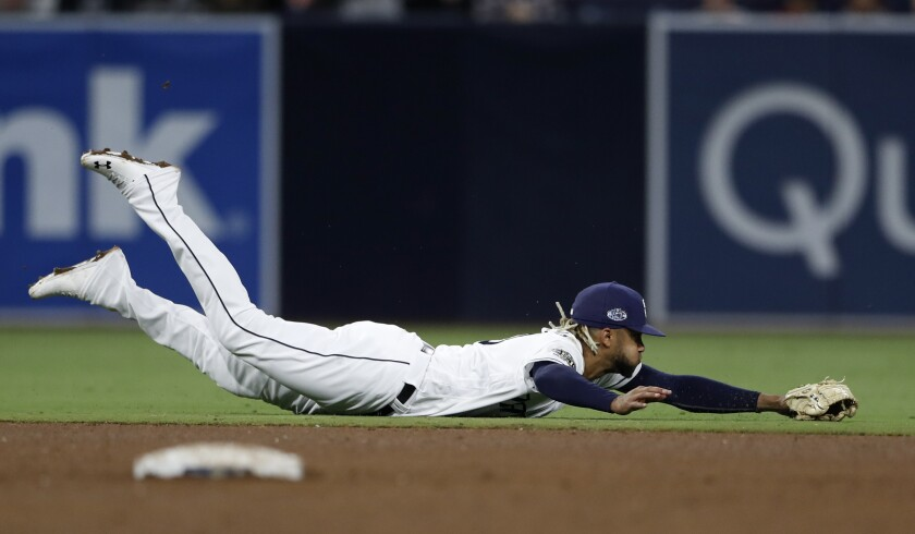 Padres shortstop Fernando Tatis Jr. dives for a ball against the Tampa Bay Rays on Monday.