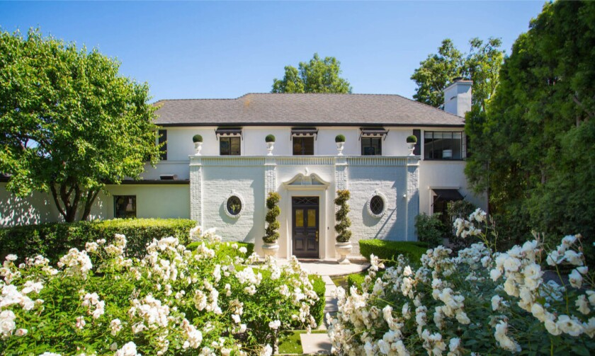 Built in 1936, the elegant Regency-style home showcases dramatic style both inside and out.