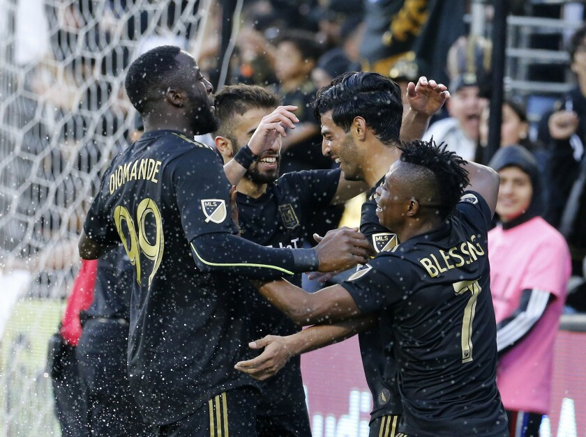 Los Angeles FC forward Carlos Vela, second from right, of Mexico, celebrates his goal with teammates in the second half of an MLS soccer match against Portland Timbers in Los Angeles, Sunday, March 10, 2019. The Los Angeles FC won 4-1.