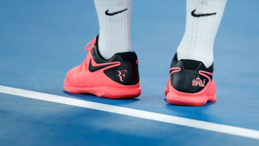 Nike shoes and socks adorn the feet of tennis star Roger Federer as he competes at the 2018 Australian Open.