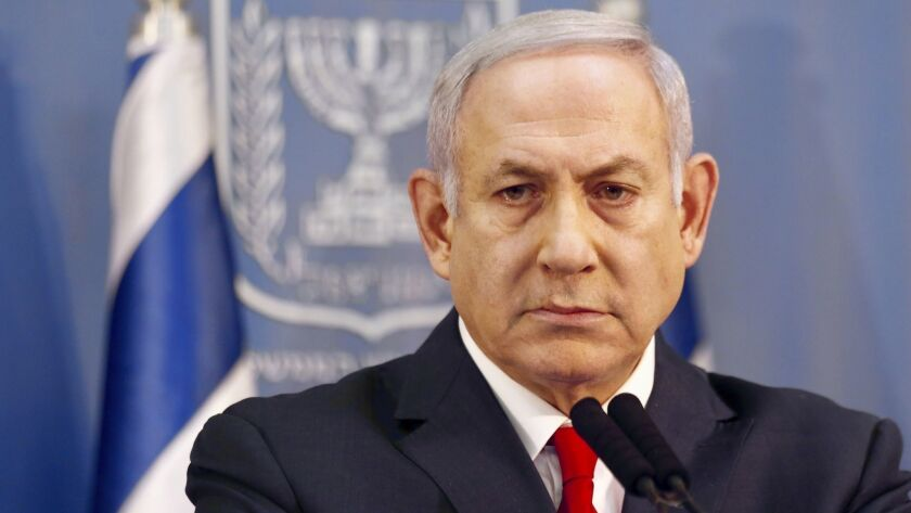 Israeli Prime Minister Benjamin Netanyahu delivers a statement in Tel Aviv on Nov. 18, 2018. Netanyahu says he will take over temporarily as defense minister as early elections still loom.