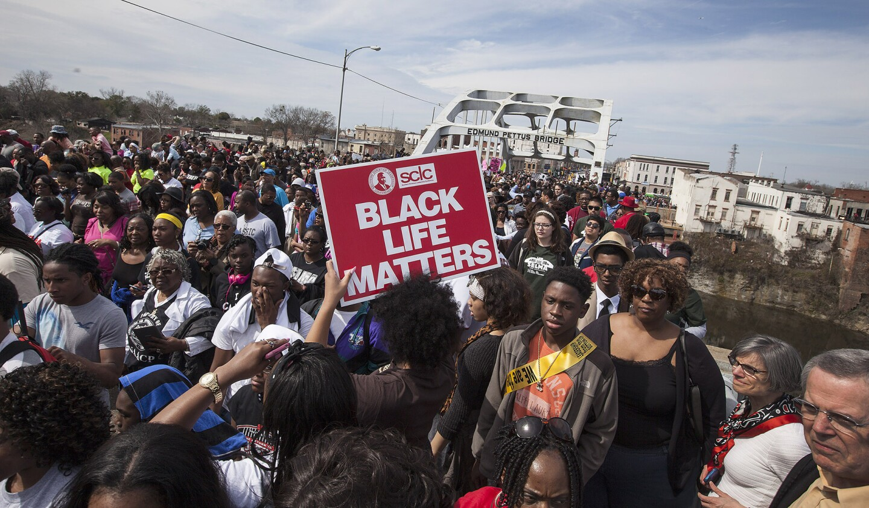 Marchers on the Edmund Pettus Bridge on March 8 in Selma.