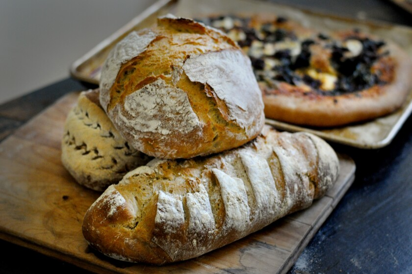 A basic daily bread recipe can be made with whole wheat flour and into different shapes, including pizza.
