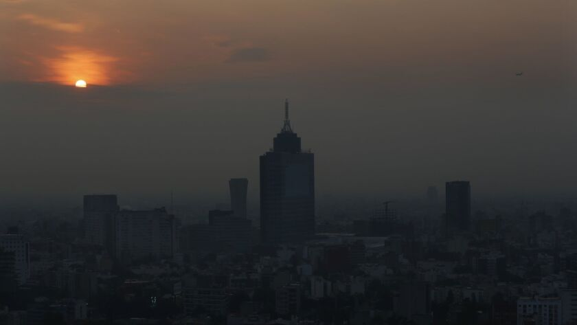 Smog blankets the sky in Mexico City, Friday, May 17, 2019. Both lower schools and universities were