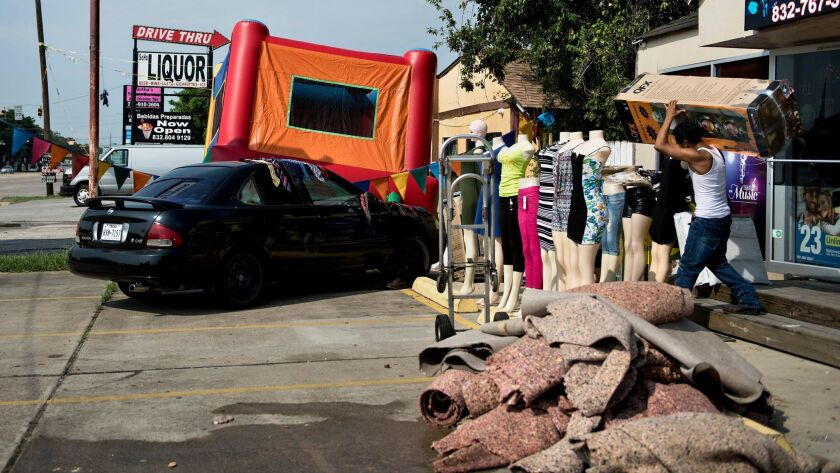 Flood-damaged items are piled outside a business after the high water receded in Houston.